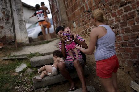 Gleyse Kelly da Silva holds Maria Giovanna, who has microcephaly, at their house in Recife, Brazil, January 30, 2016. REUTERS/Ueslei Marcelino/Files