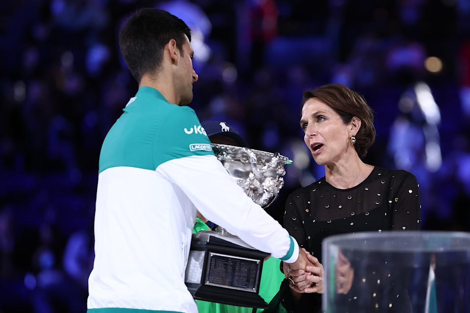 CEO of Virgin Australia Jayne Hrdlicka presents Novak Djokovic with the Norman Brookes Challenge Cup following his Men's Singles Final match against Daniil Medvedev of the 2021 Australian Open.