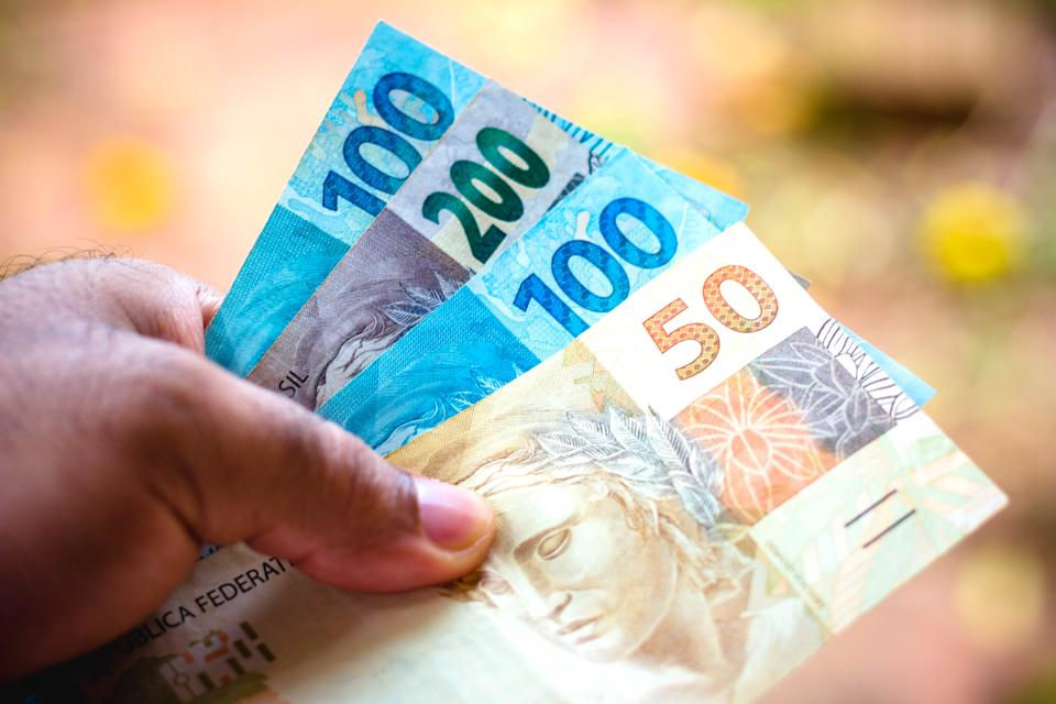 In this photo illustration the fifty and one hundred and two hundred reais banknotes is being displayed. The Real is the current money in Brazil.