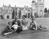 <p>Queen Elizabeth II and Prince Philip with their children, Prince Andrew, Princess Anne and Charles, sitting on a picnic rug outside Balmoral Castle.</p>
