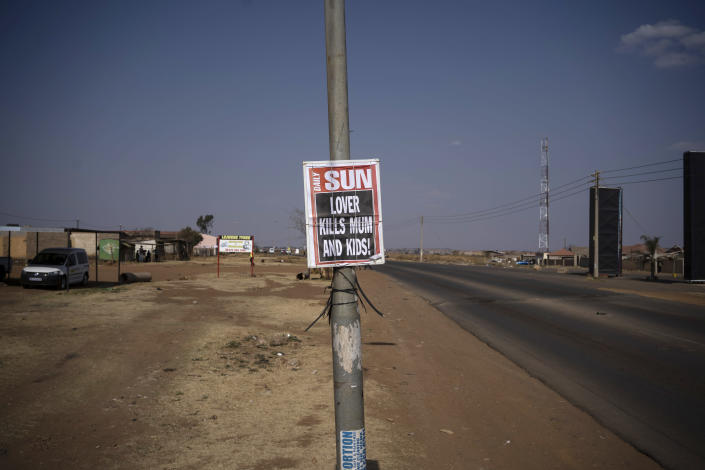 "A poster with a local newspaper headline, ""Lover Kills Mum and Kids!"" is affixed to a pole on the side of a road in Johannesburg, South Africa, on Aug. 26, 2020. According to official figures, around 1,000 kids are murdered every year in South Africa, nearly three a day. But that statistic, horrific as it is, may be an undercount. (AP Photo/Bram Janssen)"