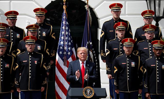 "U.S. President Donald Trump applauds as members of the United States Army Chorus sing at his ""celebration of America"" event on the South Lawn of the White House in Washington, U.S., June 5, 2018. The event was arranged after Trump canceled the planned visit of the Super Bowl champion Philadelphia Eagles to the White House. REUTERS/Kevin Lamarque"