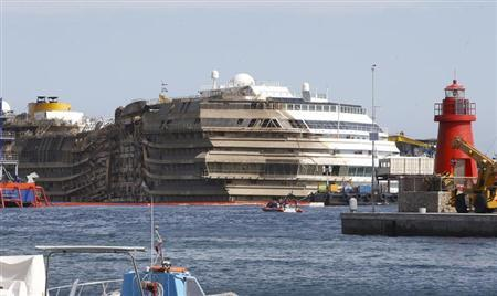 "The cruise liner Costa Concordia is seen at the end of the ""parbuckling"" operation outside Giglio harbour"