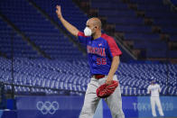 Dominican Republic's Raul Valdes (56) leaves the team's baseball game against South Korea during the sixth inning of a baseball game at the 2020 Summer Olympics, Sunday, Aug. 1, 2021, in Yokohama, Japan. (AP Photo/Sue Ogrocki)