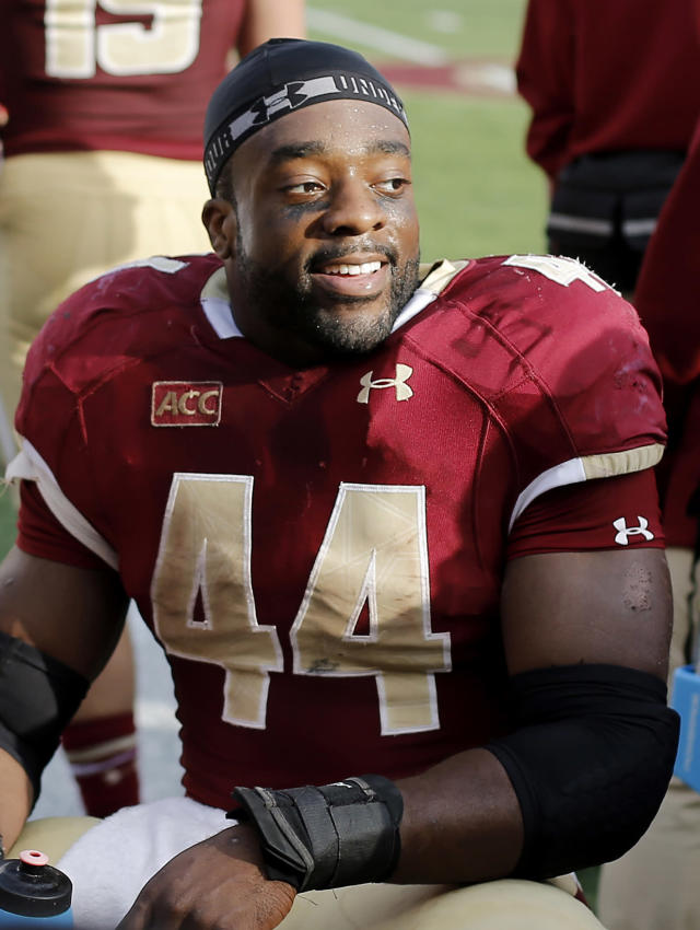 In this Nov. 2, 2013 photo, Boston College's Andre Williams smiles after scoring a touchdown during a 34-27 win over Virginia Tech in an NCAA college football game at Alumni Stadium in Boston. Williams is a Heisman Trophy finalist. (AP Photo/Winslow Townson)