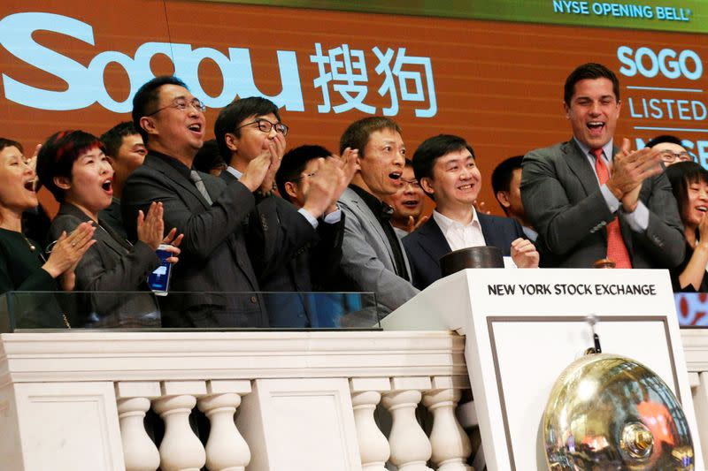FILE PHOTO: Sogou officials ring the opening bell to celebrate their company's New York market debut in 2017