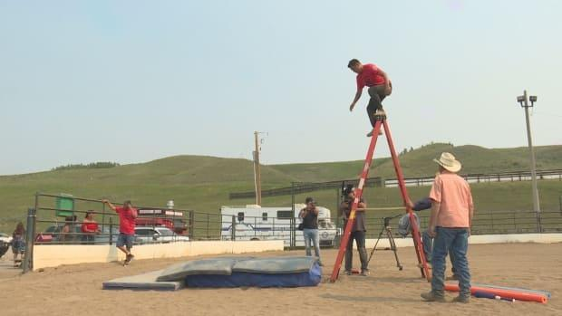 Students at Indigenous-led Stunt Nations learn how to fall properly. (Monty Kruger/CBC - image credit)