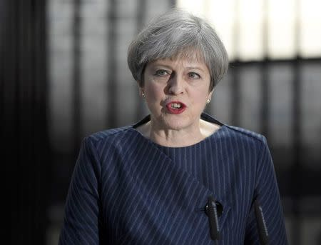 Britain's Prime Minister Theresa May speaks to the media outside 10 Downing Street, in central  London