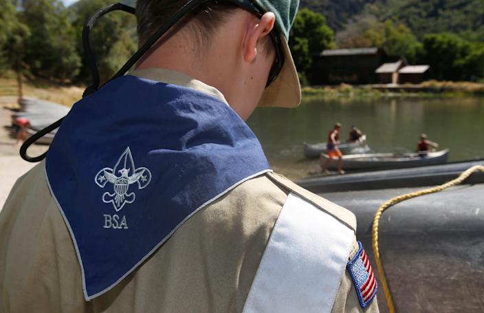 A Boy Scout works on a canoe at camp Maple Dell on July 31, 2015 outside Payson, Utah.