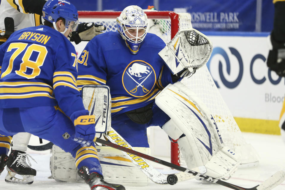 Buffalo Sabres goalie Dustin Tokarski (31) makes a save during the second period of an NHL hockey game against the Pittsburgh Penguins, Saturday, April 17, 2021, in Buffalo, N.Y. (AP Photo/Jeffrey T. Barnes)