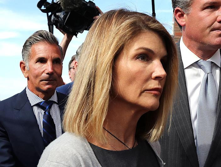 Lori Loughlin and Mossimo Giannulli, seen here in August, are expected to be brought to trial in October - but their lawyers are still pushing to change the date. (Photo by John Tlumacki / The Boston Globe via Getty Images)