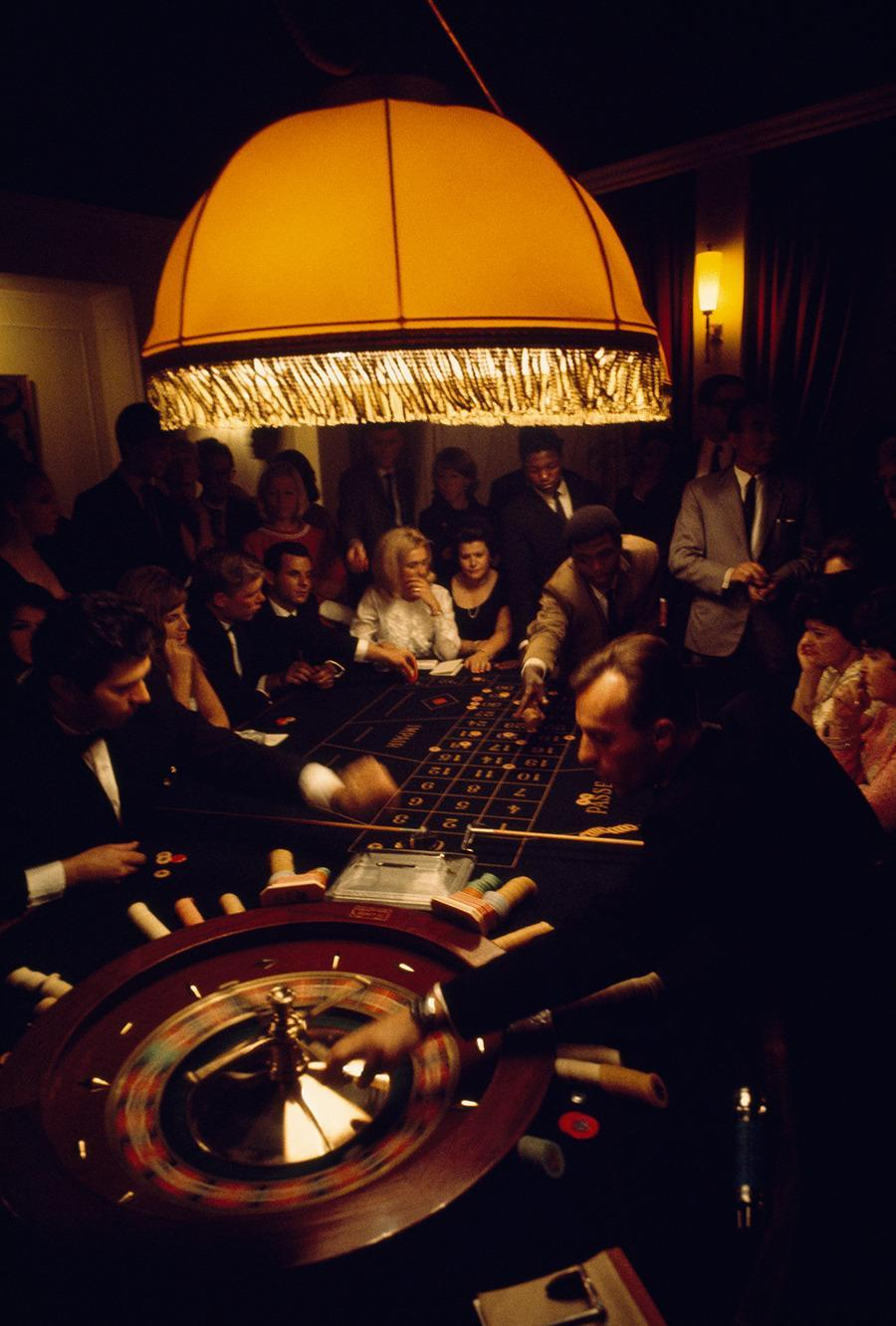 Visitors crowd a casino roulette table in Swaziland, 1969.