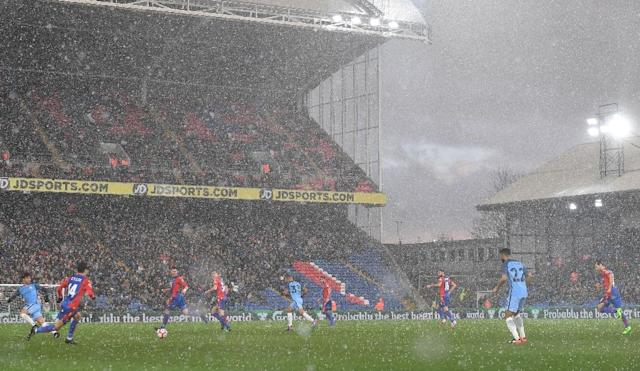 Hail falls during a brief hail storm during the English FA Cup fourth round football match between Crystal Palace and Manchester City at Selhurst Park in south London on January 28, 2017 (AFP Photo/Ben STANSALL)