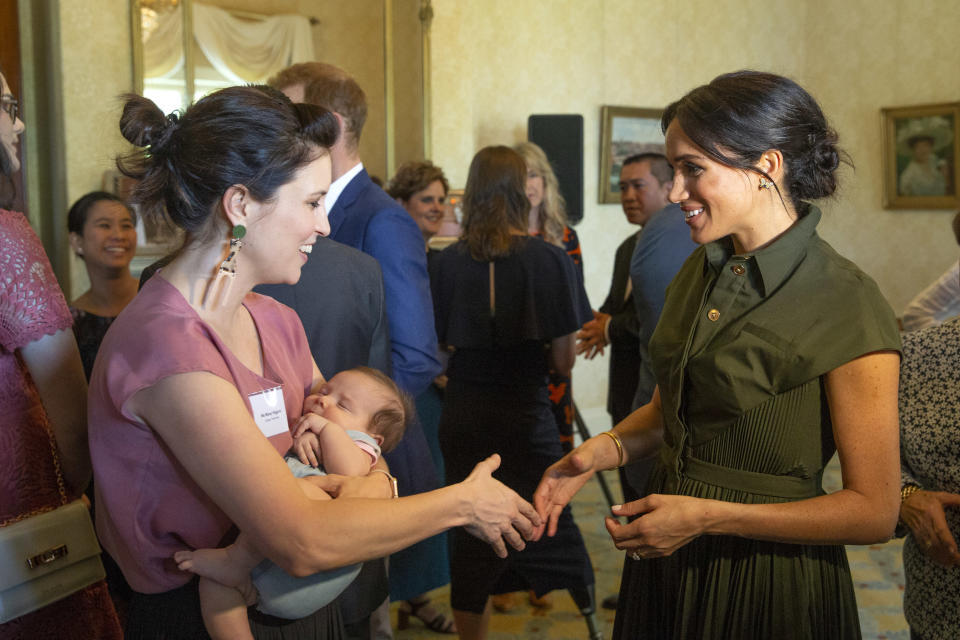 <p>Wearing the $2,500 frock, Meghan mingled with guests at Admiralty House. She is pictured here with Aussie singer Missy Higgins. Source: Getty </p>