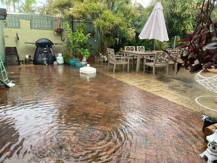 A backyard is underwater at a home in Kurnell, in Sydney's south. Source: Supplied/Siobhan Graham