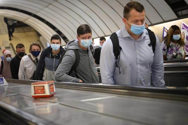 Commuters wear masks on the London underground. (Getty Images)