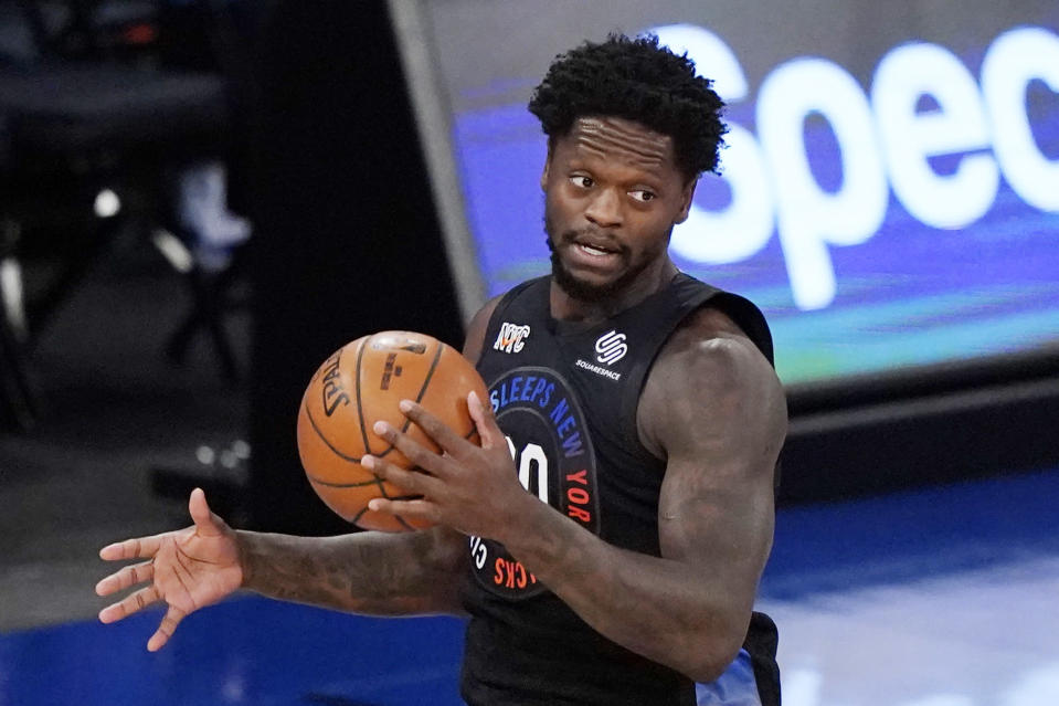 New York Knicks forward Julius Randle (30) holds onto the ball before driving down court during the first half of an NBA basketball game against the Orlando Magic, Monday, Jan. 18, 2021, in New York. (AP Photo/Kathy Willens, Pool)