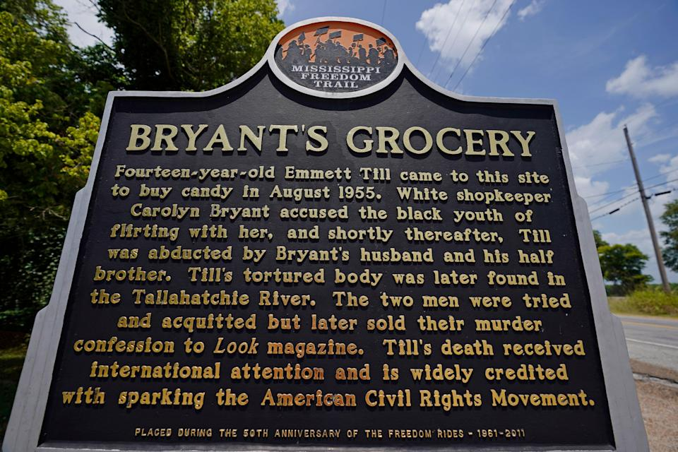 A Mississippi Freedom Trail marker sits before the remains of Bryant's Grocery and Meat Market in Money, Miss., on July 14. At the site in 1955, Emmett Till, a Black 14-year-old, was accused of whistling at a white woman.