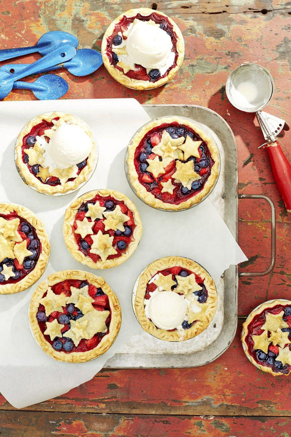"""<p>Top these tiny desserts—filled with raspberries, blueberries, and strawberries—with a large scoop of <a href=""""https://www.countryliving.com/food-drinks/g952/easy-homemade-ice-cream-0610/"""" rel=""""nofollow noopener"""" target=""""_blank"""" data-ylk=""""slk:vanilla ice cream"""" class=""""link rapid-noclick-resp"""">vanilla ice cream</a>.</p><p><strong><a href=""""https://www.countryliving.com/food-drinks/a21348015/mini-stars-berry-pies-recipe/"""" rel=""""nofollow noopener"""" target=""""_blank"""" data-ylk=""""slk:Get the recipe"""" class=""""link rapid-noclick-resp"""">Get the recipe</a></strong><strong>.</strong></p>"""