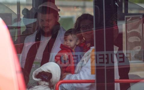 A child and other survivors from the Synagogue shooting in Halle (Saale) board a bus and are taken to safety, Several hours after the assault - Credit: Craig Stennett for the Telegraph