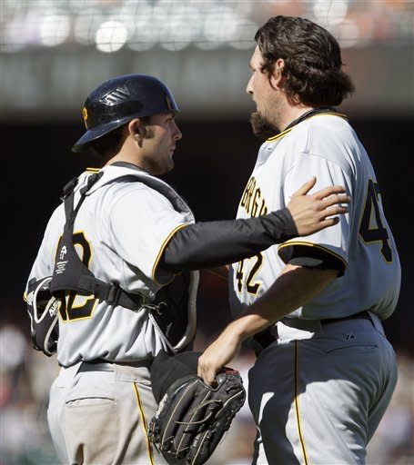 Pittsburgh Pirates' Joel Hanrahan, right, is congratulated by catcher Michael McKenry at the end of the baseball game against the San Francisco Giants Sunday, April 15, 2012, in San Francisco. The Pirates won 4-1. (AP Photo/Ben Margot)