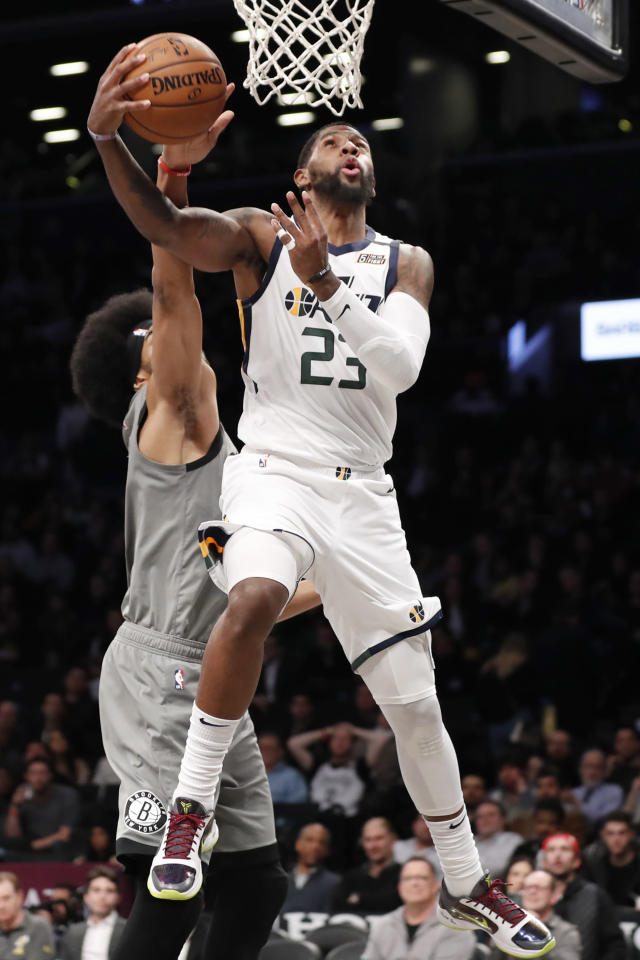 Brooklyn Nets center Jarrett Allen, left, defends against Utah Jazz forward Royce O'Neale (23) during the second half of an NBA basketball game Tuesday, Jan. 14, 2020, in New York. The Jazz won 118-107. (AP Photo/Kathy Willens)