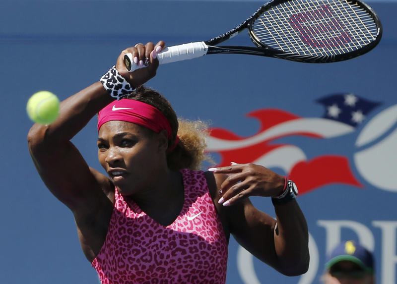 Serena Williams, of the United States, returns a shot to Vania King, of the United States, during the second round of the 2014 U.S. Open tennis tournament, Thursday, Aug. 28, 2014, in New York
