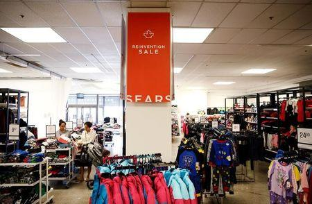 FILE PHOTO - People shop inside a Sears store in Oakville, Ontario