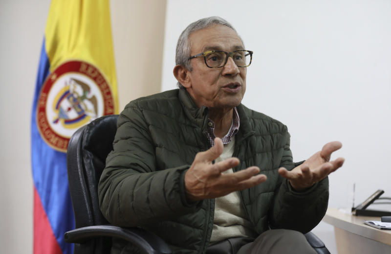 Dario Acevedo, director of the National Center for Historical Memory, speaks during an interview at his office in Bogota, Colombia, Thursday, Dec. 12, 2019. Acevedo has rejected a draft plan for the content of a planned Museum of Memory, which will pay homage to the millions of victims of the country's long civil conflict, and has publicly questioned the number of victims of the five-decade war. (AP Photo/Fernando Vergara)