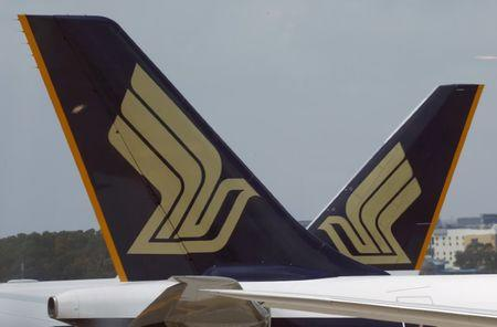 FILE PHOTO - Singapore Airlines (SIA) planes sit on the tarmac in Singapore's Changi Airport March 3, 2016. REUTERS/Edgar Su/File Photo