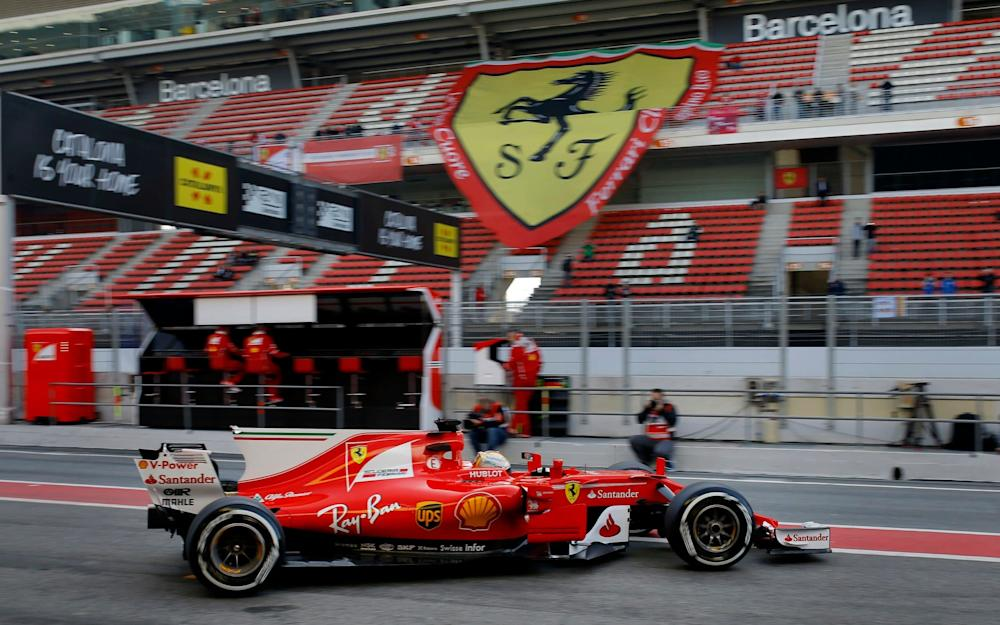 Ferrari driver Sebastian Vettel of Germany leaves the team box during a Formula One pre-season testing session at the Catalunya racetrack in Montmelo, outside Barcelona, Spain, Thursday, March 9, 2017. (AP Photo/Francisco Seco) - Credit: Francisco Seco/AP