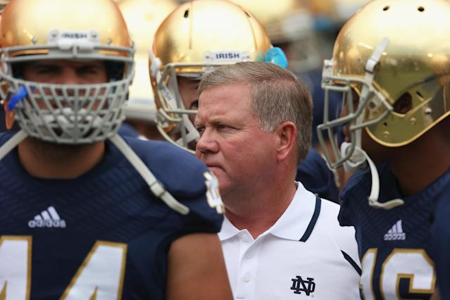 SOUTH BEND, IN - AUGUST 31: Head coach Brian Kelly of the Notre Dame Fighting Irish waits to run onto the field with his team before a game against the Temple Owls at Notre Dame Stadium on August 31, 2013 in South Bend, Indiana. (Photo by Jonathan Daniel/Getty Images)