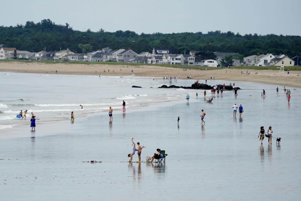 Without the annual influx of Canadian tourists, beach-goers have plenty of room to spread out, Thursday, July 1, 2021, in Old Orchard Beach, Maine. From the Atlantic to the Pacific, people along the U.S.-Canadian border are hoping the border will open again soon so people can travel in both directions. (AP Photo/Robert F. Bukaty)