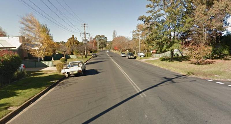 Cars are parked on the side of Racecourse Road in Orange, NSW, where a woman copped a fine for parking on her lawn.