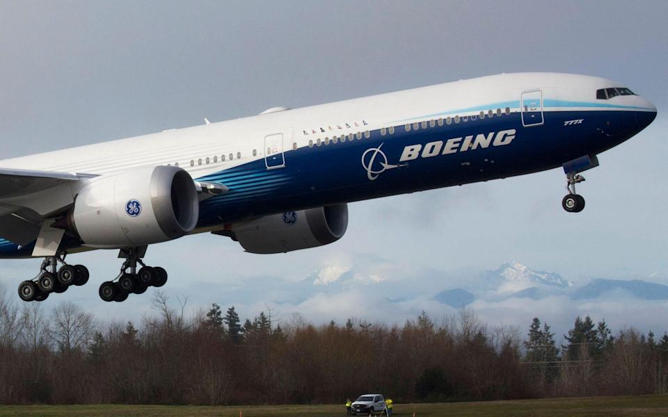 In this file photo a Boeing 777X airplane takes off on its inaugural flight at Paine Field in Everett, Washington - JASON REDMOND/AFP