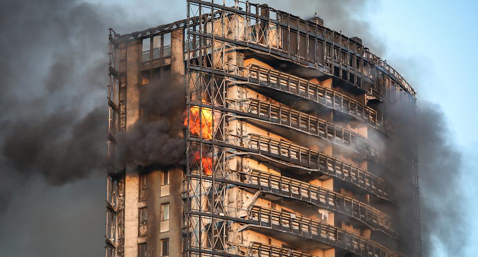 A photo of the apartment building burning in Milan.