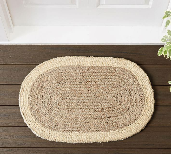 """<p><strong>Pottery Barn</strong></p><p>potterybarn.com</p><p><strong>$23.00</strong></p><p><a href=""""https://go.redirectingat.com?id=74968X1596630&url=https%3A%2F%2Fwww.potterybarn.com%2Fproducts%2Foval-natural-fiber-doormat&sref=https%3A%2F%2Fwww.cosmopolitan.com%2Flifestyle%2Fg36559937%2Fcute-doormats%2F"""" rel=""""nofollow noopener"""" target=""""_blank"""" data-ylk=""""slk:Shop Now"""" class=""""link rapid-noclick-resp"""">Shop Now</a></p><p>You could also go for this oval-shaped mat for an understated look that's still hella chic.</p>"""