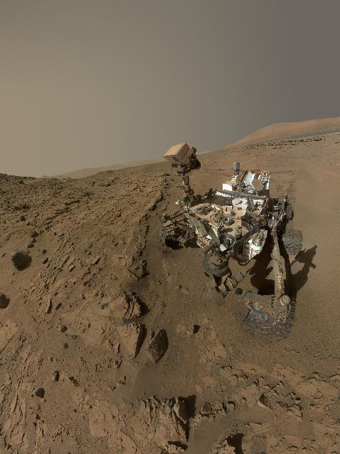 "In this image released on June 23, 2014, shows NASA's Curiosity Mars rover self-portrait. NASA's Curiosity Mars used the camera at the end of its arm in April and May 2014 to take dozens of component images combined into this self-portrait where the rover drilled into a sandstone target called ""Windjana."" NASA's Mars Curiosity rover will complete a Martian year, 687 Earth days, on June 24. (AP Photo/NASA/JPL-Caltech/MSSS)"