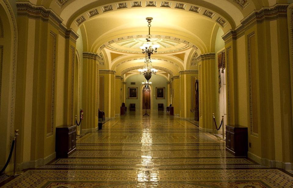 A hallway outside the Senate chamber is empty during the tenth hour of a floor speech by Sen. Ted Cruz, R-Texas, on Wednesday, Sept. 25, 2013 in Washington. Cruz began a lengthy speech urging his colleagues to oppose moving ahead on a bill he supports. The measure would prevent a government shutdown and defund Obamacare. (AP Photo/ Evan Vucci)