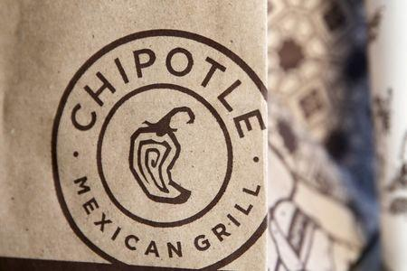 A logo of Chipotle Mexican Grill is seen on one of their bags in Manhattan, New York November 23, 2015. REUTERS/Andrew Kelly