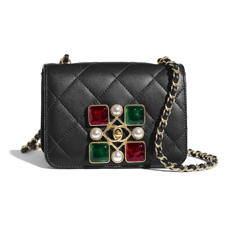 """<p>chanel.com</p><p><strong>$4200.00</strong></p><p><a href=""""https://go.redirectingat.com?id=74968X1596630&url=https%3A%2F%2Fwww.chanel.com%2Fus%2Ffashion%2Fp%2FAS2251B04579N9800%2Fsmall-flap-bag-calfskin-crystal-pearls-resin-gold-tone-metal%2F&sref=https%3A%2F%2Fwww.elle.com%2Ffashion%2Fshopping%2Fg34551759%2Ffall-investment-bags-2020%2F"""" rel=""""nofollow noopener"""" target=""""_blank"""" data-ylk=""""slk:Shop Now"""" class=""""link rapid-noclick-resp"""">Shop Now</a></p>"""