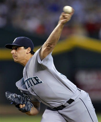 Seattle Mariners pitcher Jason Vargas delivers against the Arizona Diamondbacks during the first inning of an interleague baseball game, Wednesday, June 20, 2012, in Phoenix. (AP Photo/Matt York)