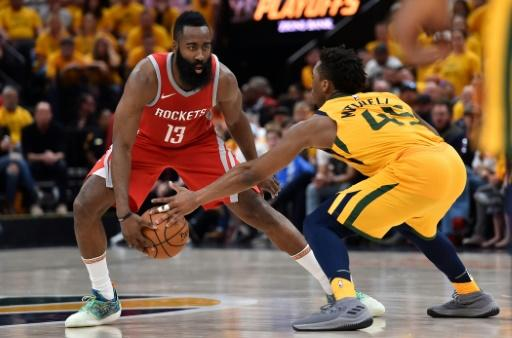 Donovan Mitchell (R) of the Utah Jazz knocks the ball from the hands of James Harden of the Houston Rockets during game four of the playoffs