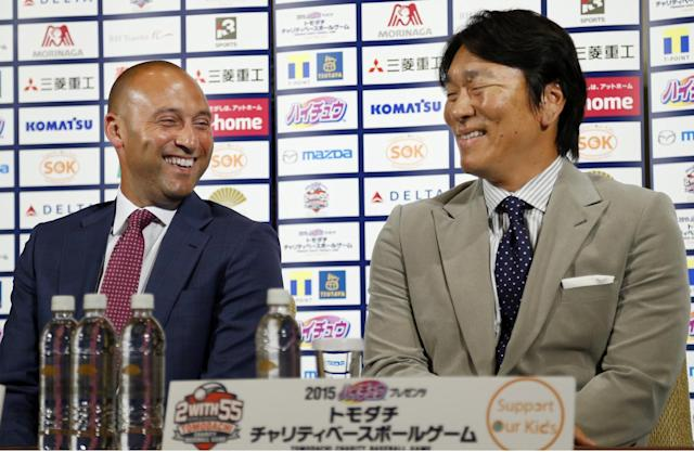 Former NY Yankees Derek Jeter, left, and Hideki Matsui smile during a press conference on a charity baseball game in Tokyo, Wednesday, March 18, 2015. Jeter is teaming up with Matsui to support the survivors of the 2011 earthquake and tsunami - and hinted he may someday get back into baseball as a team owner. The event will be held on Sunday at Tokyo Dome. (AP Photo/Shizuo Kambayashi)