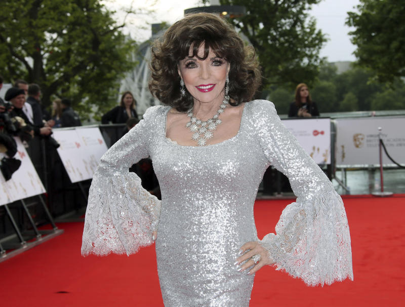 "FILE - In this Sunday, May 14, 2017 file photo, Joan Collins poses for photographers upon arrival to the British Academy Television Awards at the Royal Festival Hall in London. Joan Collins has thanked firefighters for their quick response after a blaze erupted in her London apartment. The 85-year-old actress on Monday, April 15, 2019 shared video images of a charred wall on social media after the weekend fire. She also tweeted thanks to the ""marvelous"" firefighters who tackled the ""terrifying"" blaze.  (Photo by Joel Ryan/Invision/AP, file)"