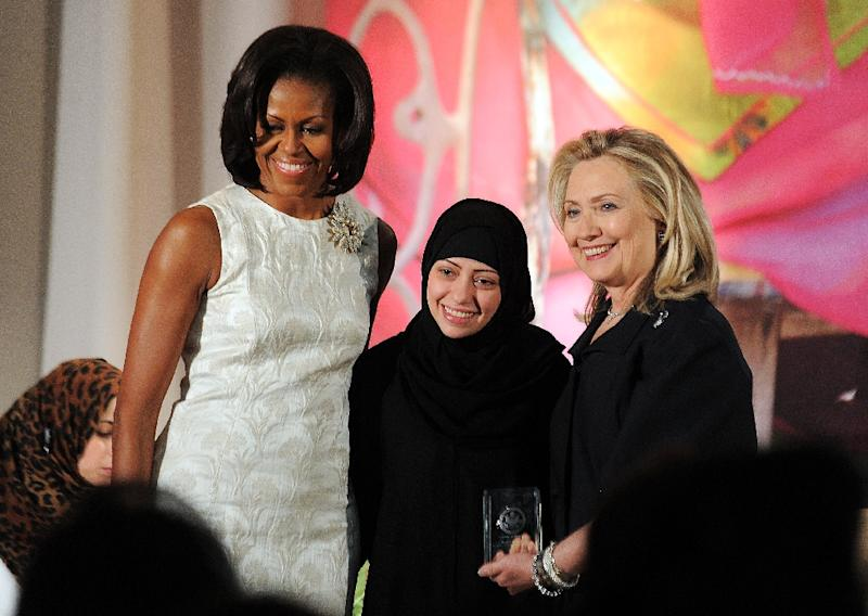 Saudi activist Samar Badawi (C) with Hillary Clinton (R), then US Secretary of State, and Michelle Obama in Washington, DC on March 8, 2012 (AFP Photo/Jewel SAMAD)