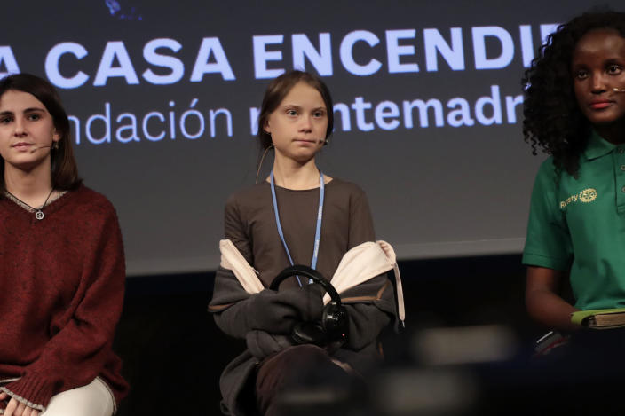 Climate activist Greta Thunberg arrives for a press conference in Madrid, Friday Dec. 6, 2019. Thunberg arrived in Madrid Friday to join thousands of other young people in a march to demand world leaders take real action against climate change. (AP Photo/Bernat Armangue)