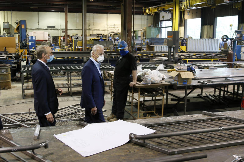 Democratic presidential candidate, former Vice President Joe Biden, center, and McGregor Industries owner Bob McGregor take a tour of the metal fabricating facility, Thursday, July 9, 2020, in Dunmore, Pa. (AP Photo/Matt Slocum)