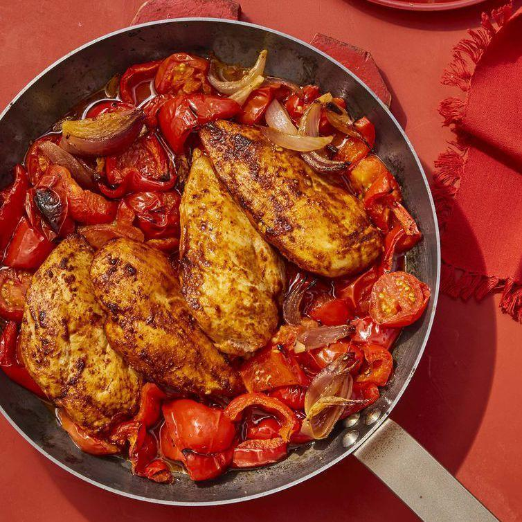"""<p>Smoked paprika, peppers, and sliced almonds give this pan roast a Spanish flair.</p><p><em><a href=""""https://www.womansday.com/food-recipes/food-drinks/a25810157/chicken-with-stewed-peppers-and-tomatoes-recipe/"""" rel=""""nofollow noopener"""" target=""""_blank"""" data-ylk=""""slk:Get the recipe for Chicken with Stewed Peppers and Tomatoes."""" class=""""link rapid-noclick-resp"""">Get the recipe for Chicken with Stewed Peppers and Tomatoes.</a></em></p>"""