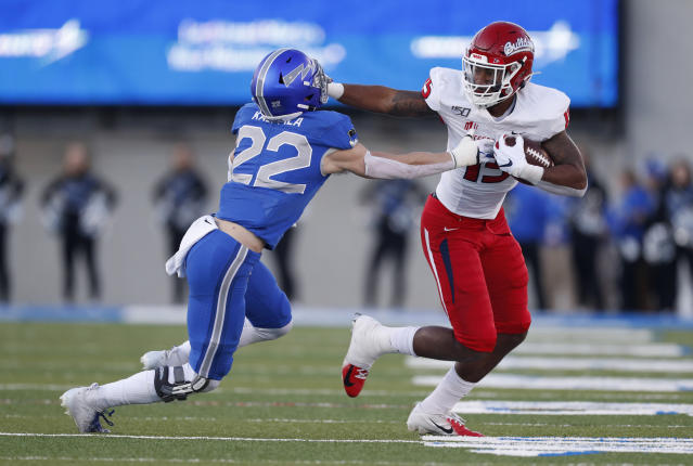 Fresno State tight end Cam Sutton, right, stiff arms to Air Force defensive back Garrett Kauppila after pulling in a pass for a short gain in the first half of an NCAA college football game Saturday, Oct. 12, 2019, at Air Force Academy, Colo. (AP Photo/David Zalubowski)